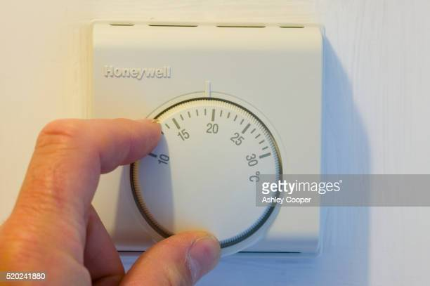 Turning a Central Heating Thermostat Down to Save Energy