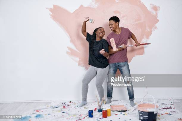 turning a paint job into a party for two - artist stock pictures, royalty-free photos & images
