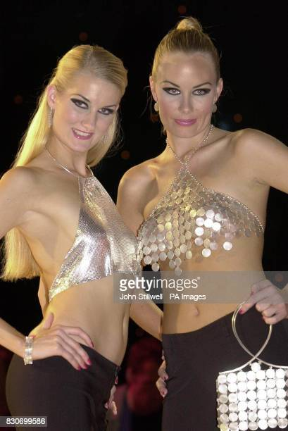 Turning heads at the International jewellery show 2001 at Earls Court in London was Carla wearing a sterling silver bra at 750 and Heidi in a disc...