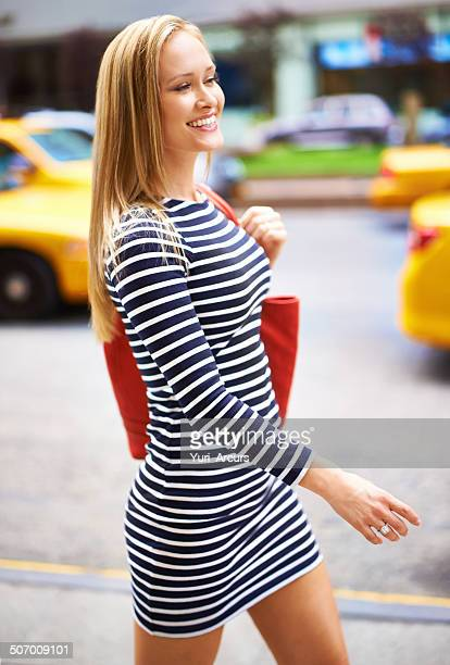 turning heads in the city - long purse stock photos and pictures