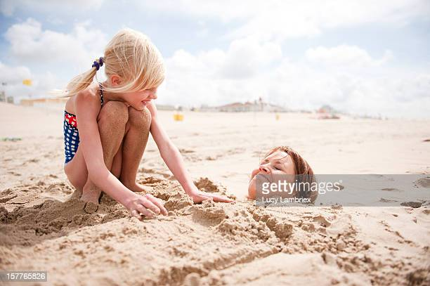 Turning mom into a sand mermaid