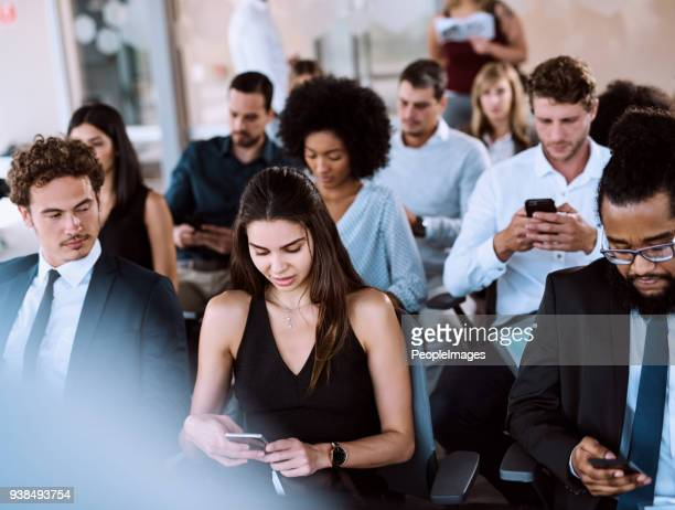 turning off their phones before the presentation begins - participant stock pictures, royalty-free photos & images