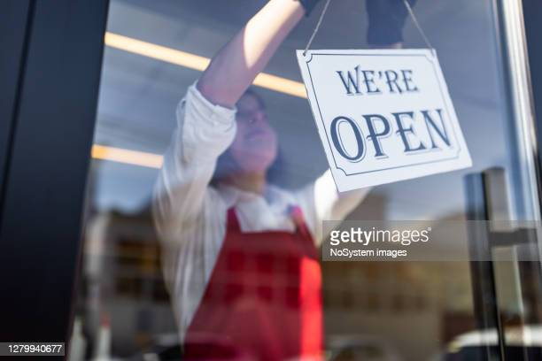 turning open sign - turning stock pictures, royalty-free photos & images