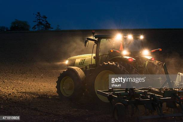 turning the field - john deere tractor stock photos and pictures