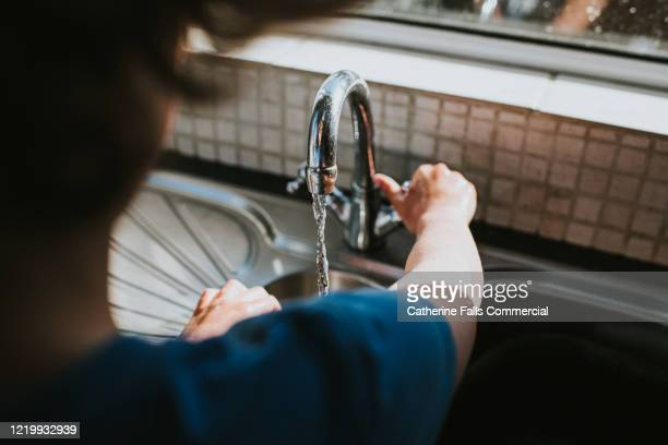 turning the tap on - turning on or off stock pictures, royalty-free photos & images