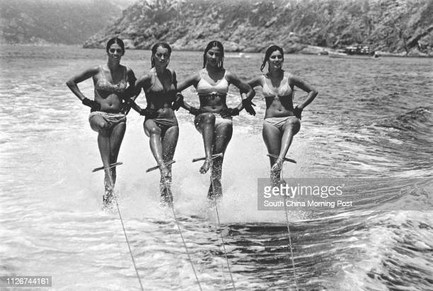 Turning tricks off Deep Water Bay under the auspices of the Hong Kong Motor Boat and Ski Club were these four aquatic athletes who were on a visit...