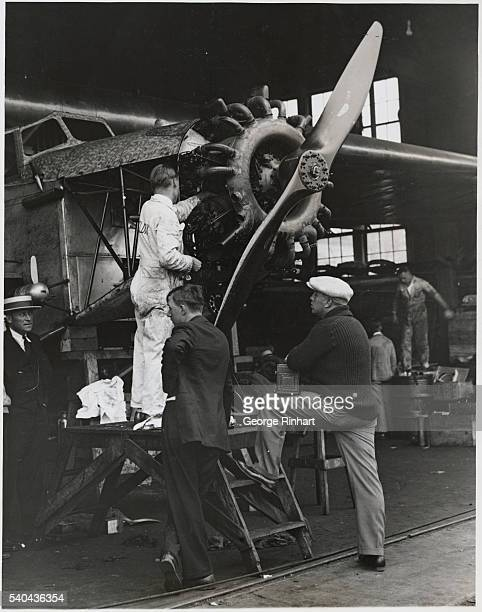 Turning Up the Motor of the Fokker Monoplane Old Glory for the Last Time Before the HopOff to Rome Curtiss Field Long Island The final preparations...