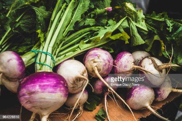 turnips on a market stall in ponte de lima - turnip stock pictures, royalty-free photos & images
