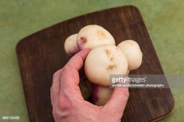 Turnips on wooden board.