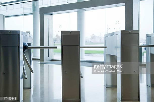 Turnstiles in building lobby