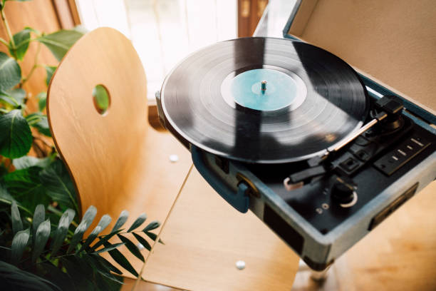 Turntable on glass table at home