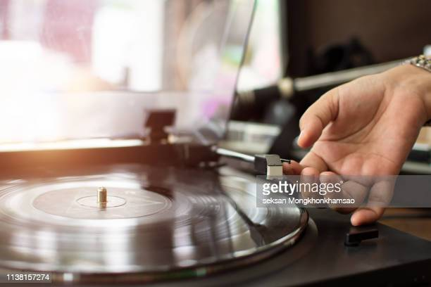 turntable vinyl record player with hand - record analog audio stock pictures, royalty-free photos & images