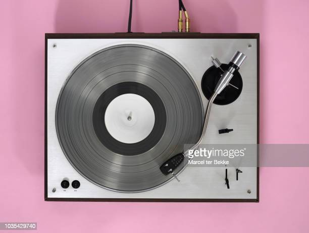 turntable with spinning record - deck stock pictures, royalty-free photos & images