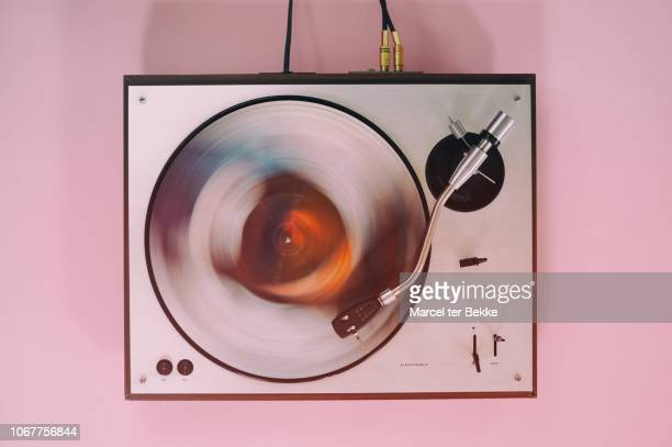 turntable with spinning record - record analog audio stock pictures, royalty-free photos & images