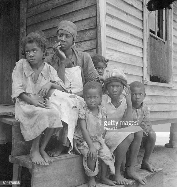 Turpentine worker's family near Cordele Alabama Father's wages one dollar a day This is the standard of living the turpentine trees support Dorothea...