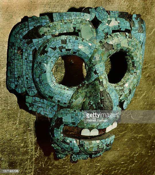 Turquoise and shell encrusted mask of Quetzalcoatl the Feathered Serpent The face is formed by the intertwining of a blue serpent and a green serpent...
