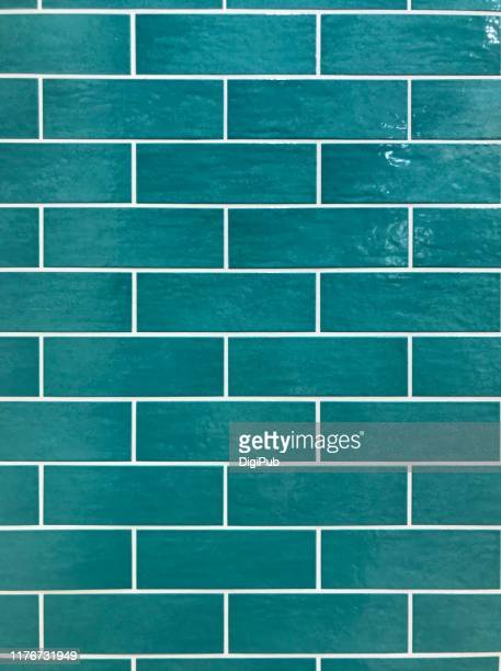 turquoise color tiled wall - ceramic stock pictures, royalty-free photos & images