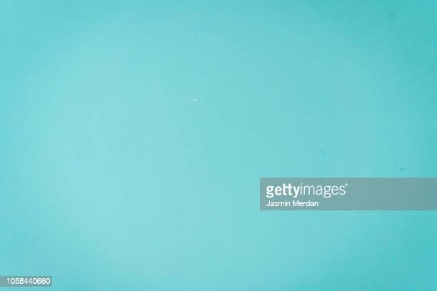 turquoise colored pastel paper background - watercolor background stock pictures, royalty-free photos & images