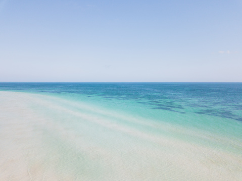 Turquoise colored sea and beach with clear blue sky. Aerial view or drone view. - gettyimageskorea