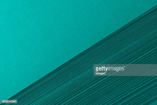 turquoise green colored paper stacking - torto imagens e fotografias de stock