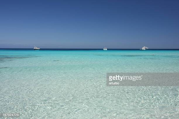 turquoise mediterranean sea and yachts
