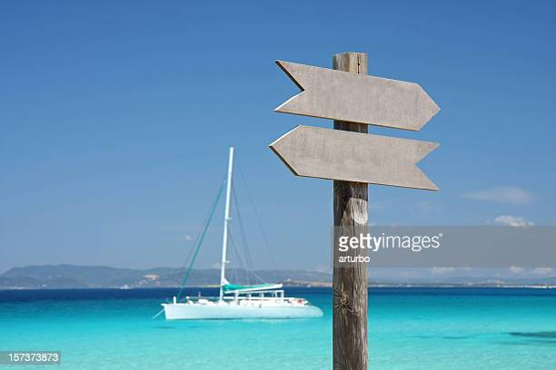 turquoise mediterranean sea with sign and yacht