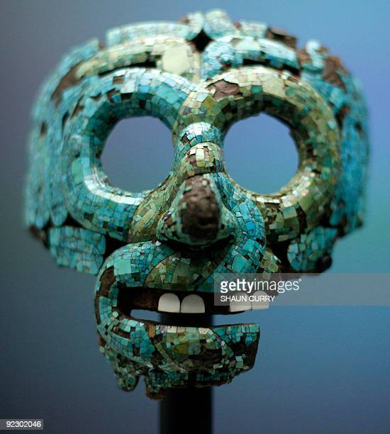 A turquoise mosaic mask dating from 13501521 known as 'The Mask of Tlaloc' is pictured at the 'Moctezuma Aztec Ruler' exhibition at the British...