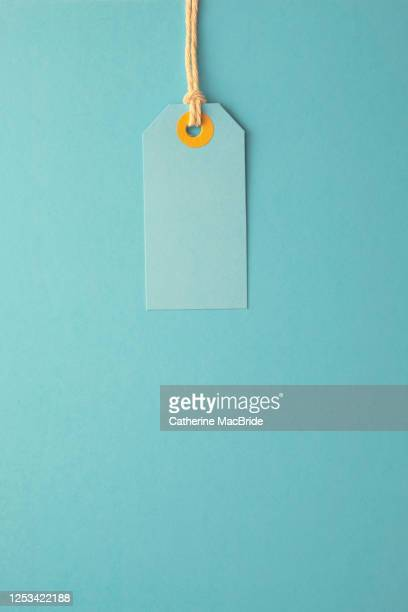 turquoise paper label on a turquoise background - catherine macbride stock pictures, royalty-free photos & images