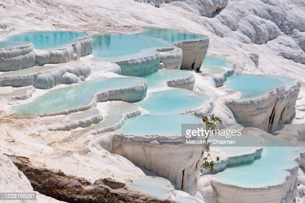 turquoise pools in travertine terraces at pamukkale, turkey - chalk rock stock pictures, royalty-free photos & images
