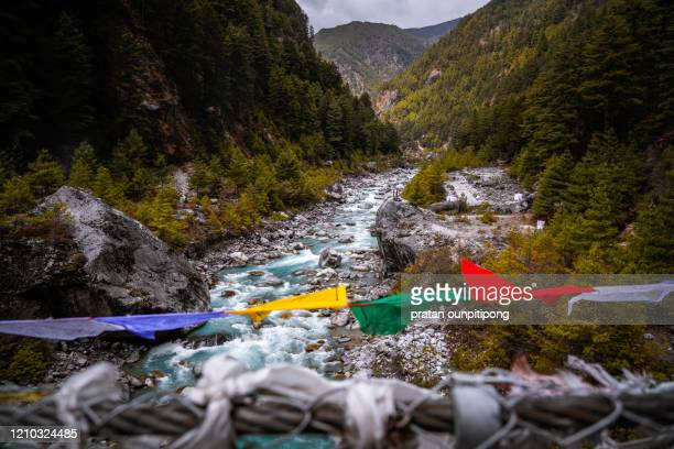 turquoise river in himalaya - suspension bridge stock pictures, royalty-free photos & images