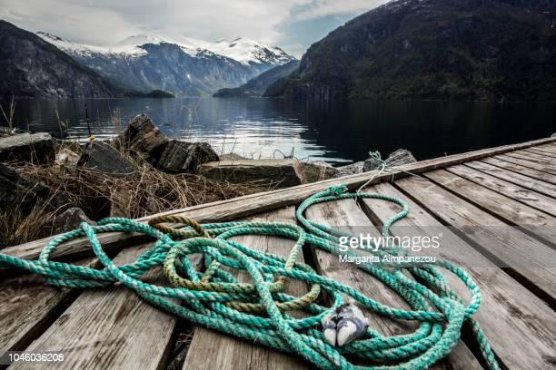 Turquoise rope on a wooden platform in the fjords of Norway