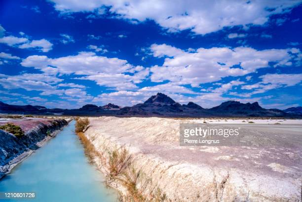 turquoise salted water rivulet at bonneville salt flats - bonneville salt flats stock pictures, royalty-free photos & images