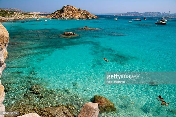 Turquoise sea and boats at La Maddalena