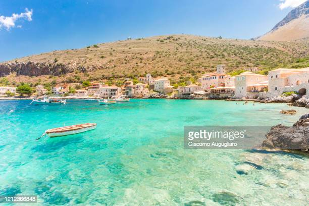 turquoise sea at the coastal village of limeni, mani region, peloponnese, greece, europe - greece stock pictures, royalty-free photos & images