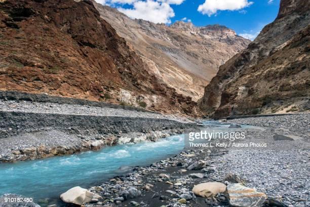 Turquoise stream feeding into Zanskar River, Ladakh Region, Jammu and Kashmir, India