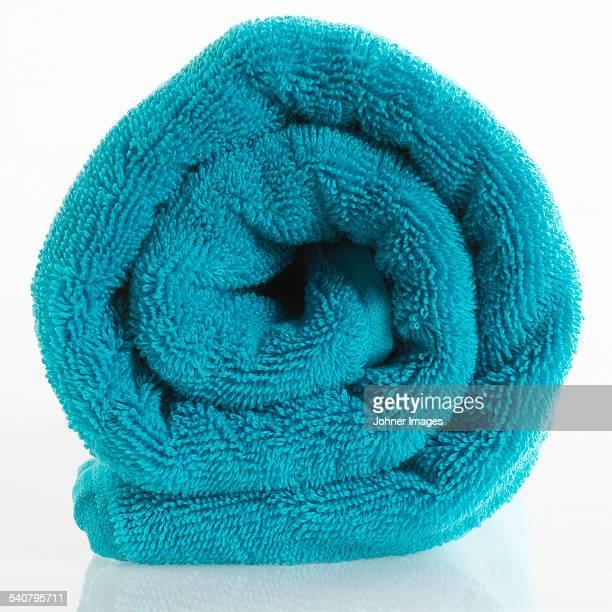 Turquoise towel on white background