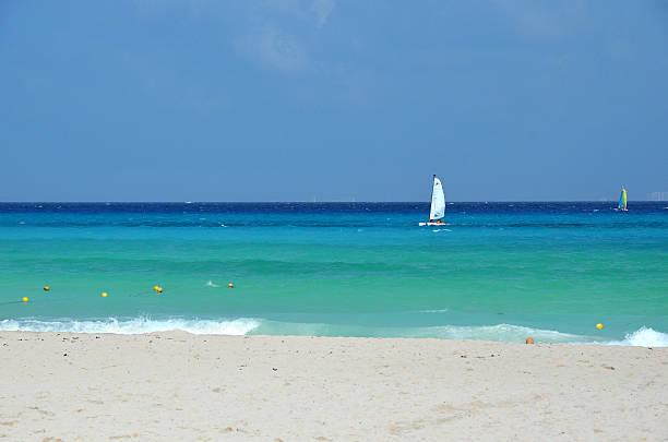 Turquoise Tropical Lagoon and a Sailing Boat, Playa del Carmen, Yucatan Peninsula, Mexico