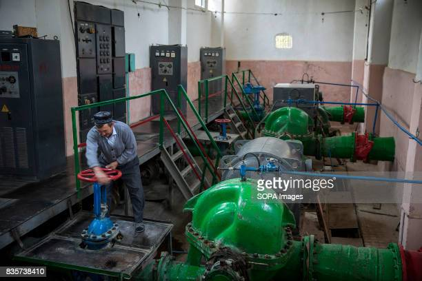 Tursunaly Turaev overseas an antiquated water pump station in the village of Andarhan The station which was built in 1975 by the Soviet Union...