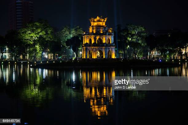 Turtle Pagoda sitting in the middle of Hoan Kiem Lake or 'Lake of the Returned Sword' is in the historical center of Hanoi the capital of Vietnam The...