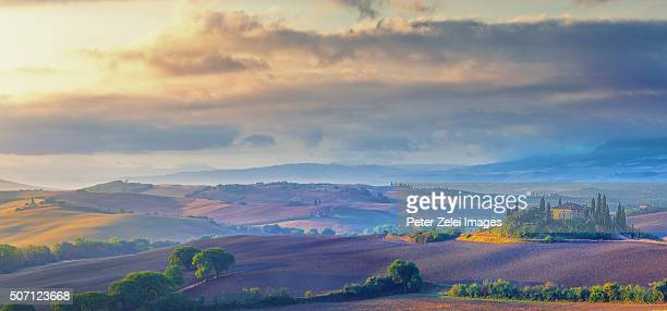 Tuscan landscape at sunrise, location: Val d'Orcia, Tuscany, Italy.