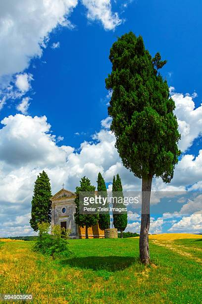 tuscan landscape with the capella di vitaleta in the summer - italian cypress stock photos and pictures
