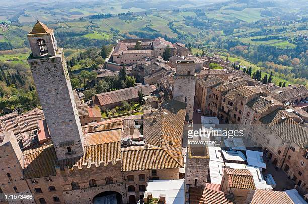tuscany aerial view over hilltop town towers san gimignano italy - siena italy stock pictures, royalty-free photos & images