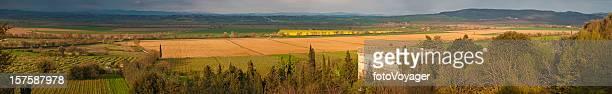 Tuscany golden sunlight vineyards villages valleys villas Siena Italy panorama