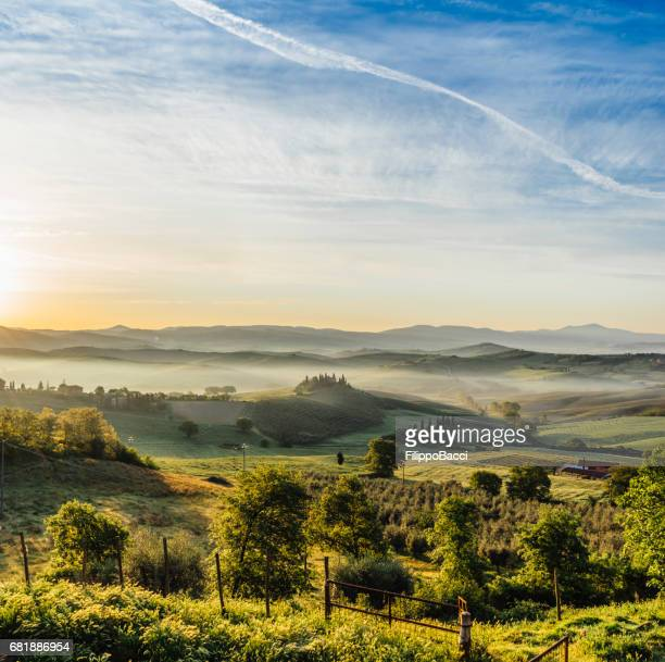 tuscany landscape at sunrise with low fog - val d'orcia stock pictures, royalty-free photos & images
