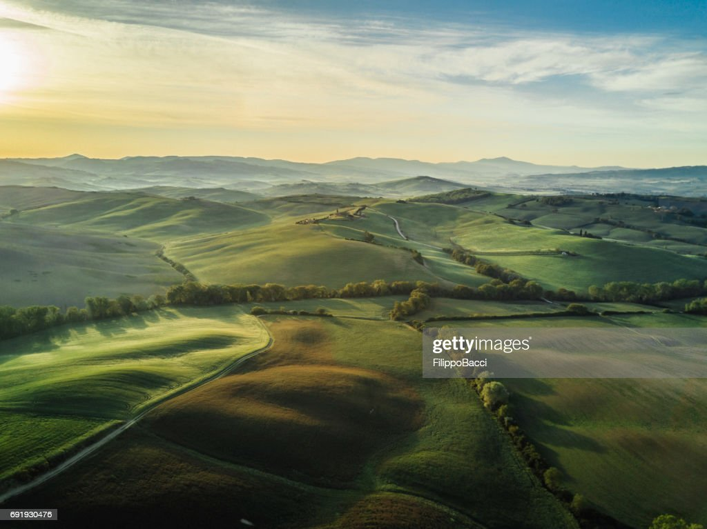 Tuscany landscape at sunrise with low fog : Stock Photo