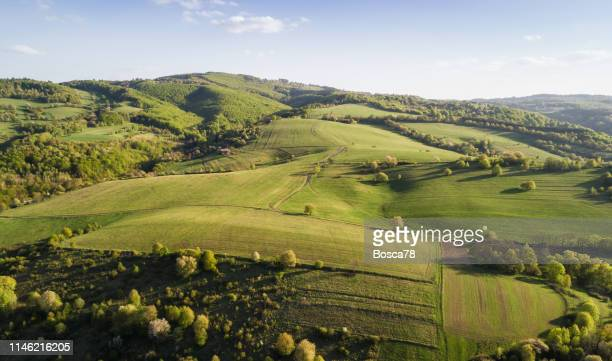 tuscany landscape at sunset - hill stock pictures, royalty-free photos & images