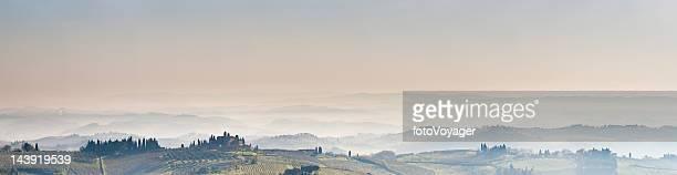 Tuscany misty morning panorama vineyards villas and valleys Italy