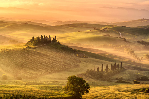 Tuscany, rural sunrise landscape. Countryside farm, cypresses trees, green field,Italy, Europe. - gettyimageskorea
