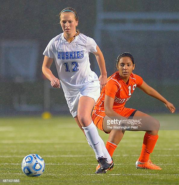 Tuscorora's Abby Downey left get way with ball from Briar Woods' Mia Venkat during Briar Woods defeat of Tuscarora 3 0 in girls soccer at Tuscarora...