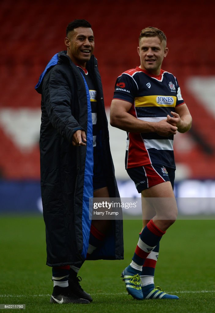 Tusi Pisi of Bristol Rugby and Ian Madigan of Bristol Rugby share a joke at the final whistle during the Greene King IPA Championship match between Bristol Rugby and Hartpury College at Ashton Gate on September 3, 2017 in Bristol, England.